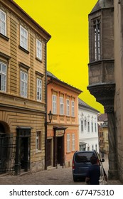 Baroque building fronts on narrow street of  Kutna Hora, Czech Republic