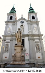 The Baroque Church of Mariahilf and statue of musician Franz Joseph Haydn in Vienna, Austria