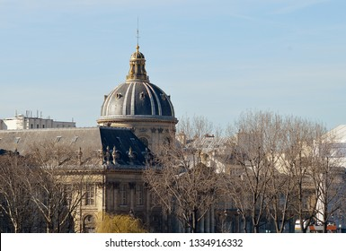 The baroque cupola of the Institut de France, the fice academies, towers above the rooftops of Paris and teh intellectural life of France