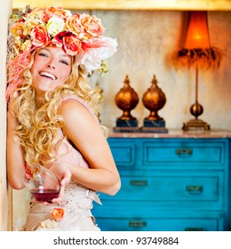 baroque fashion blond woman drinking red wine in grunge house
