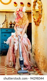 baroque fashion blonde housewife woman at vacuum cleaner chores