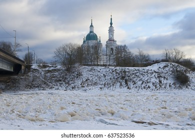 Baroque Orthodox Russian church on the bank of the frozen river.