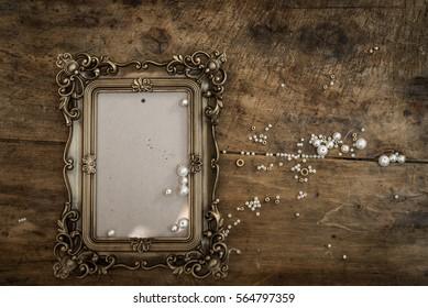 baroque photo frame on wood
