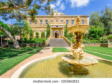 Barossa Valley, Chateau Yaldara, South/ Australia - 10 19 2017: Wonderful green spring summer view to an old vineyard building situated in wine grape valley of the great ocean road with golden well