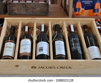 Barossa Valley, South Australia/Australia - 01.07.2018: Display of Jacobs Creek wine bottles. Collection of different wine bottles inside a wooden gift box. A soft focus