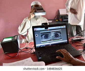Barpeta, Assam, India. 10 August 2019. People takes an iris scan to link her Aadhar card with National Register of Citizens (NRC) during a hearing at a NRC Seva Kendra (PSK) in Barpeta.