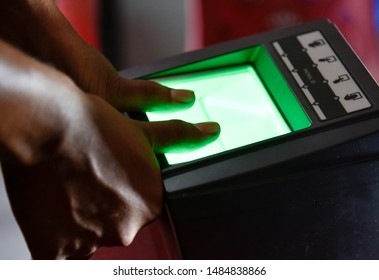Barpeta, Assam, India. 10 August 2019. People takes finger print scan to link  Aadhar card with National Register of Citizens (NRC) during a hearing at a NRC Seva Kendra (PSK) in Barpeta.