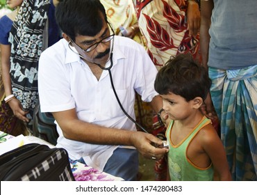 Barpeta, Assam, India. August 7, 2019.  Doctor  treats flood victims at a free medical health camp at a flood affected village in Assam.