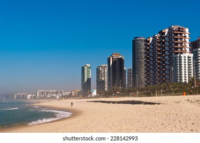 Barra da Tijuca Beach with Luxury Condominium Apartment and Hotel Buildings on Sunny Day in Rio de Janeiro, Brazil