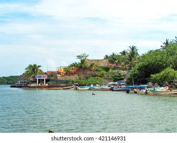 BARRA DE NAVIDAD, MEXICO - CIRCA OCTOBER 2009: Waterfront restaurant on the bay with boat parking beside it