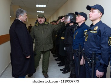 At the barrack. Officer showing soldier's outfit to the President of Ukraine Petro Poroshenko. Opening International training centre of National guard of Ukraine. March 23, 2018. Staroe, Ukraine