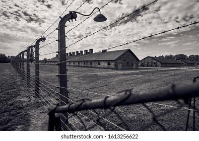 Barracks seen through the barbed wire
