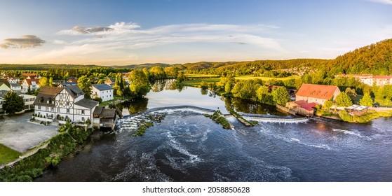 Barrage and weir of the river Regen in Markt Regenstauf in the Upper Palatinate, Germany - Shutterstock ID 2058850628