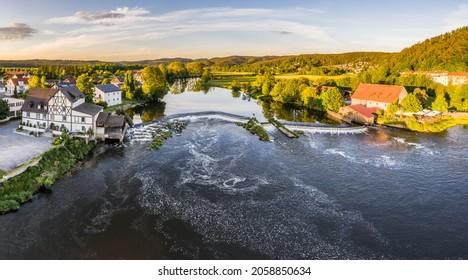 Barrage and weir of the river Regen in Markt Regenstauf in the Upper Palatinate, Germany - Shutterstock ID 2058850634