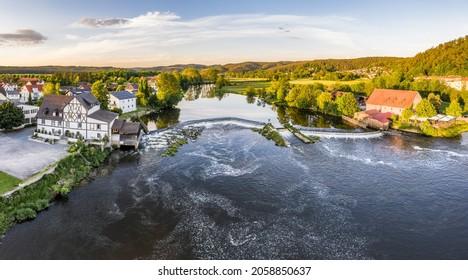 Barrage and weir of the river Regen in Markt Regenstauf in the Upper Palatinate, Germany - Shutterstock ID 2058850637
