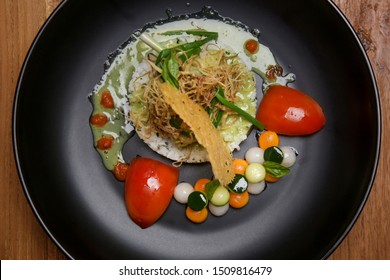 barramundi filet on basil sauce served with white rice and vegetable. Exquisite dish. Creative restaurant meal concept.