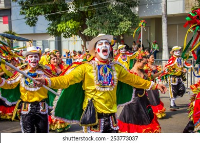 BARRANQUILLA, COLOMBIA - FEBRUARY 15, 2015: Performers with colorful and elaborate costumes participate in the Great Parade of Carnaval dePerformers with colorful and elaborate customs participate in