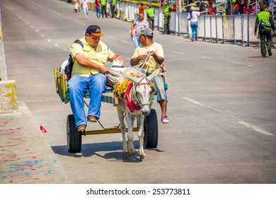 BARRANQUILLA, COLOMBIA - FEBRUARY 15, 2015: Street vendors in Colombia's most important folklore celebration, the Carnival of Barranquilla, Colombia, with a Hosrse pulling a cart with food