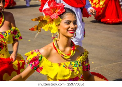 BARRANQUILLA, COLOMBIA - FEBRUARY 15, 2015: Performers with colorful and elaborate costumes participate in the Great Parade of Carnaval Smiling woman