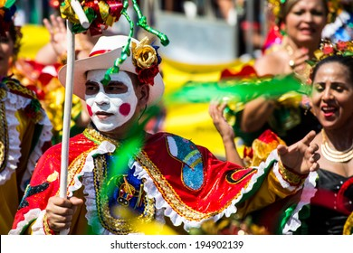 Barranquilla, Colombia - March 1, 2014 - Performers in elaborate costume sing, dance, and stroll their way down the streets of Barranquilla during the Battalla de Flores during Carnival