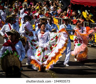 Barranquilla, Colombia - March 1, 2014 - Performers in elaborate costume sing, dance, and stroll their way down the streets of Barranquilla during the Battalla de Flores, Carnaval de Barranquilla.