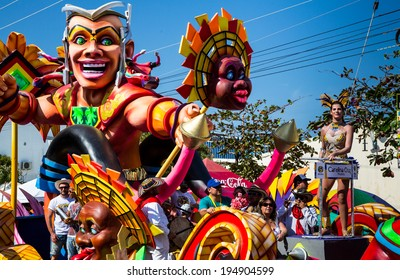 Barranquilla, Colombia - March 1, 2014 - Colorful floats full of singers, dancers, and models make their way down the street during the Battalla de Flores. The pinnacle of the Carnaval de Barranquilla