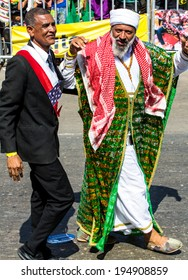 Barranquilla, Colombia - March 1, 2014 - Performers dressed as Barack Obama and Osama bin Laden have the crowd cheering as the participate in the Battalla de Flores, Carnaval de Barranquilla.