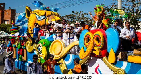 Barranquilla, Colombia - March 1, 2014 - Colorful floats full of singers, dancers, and models make their way down the street during the Battalla de Flores parade of the Carnaval de Barranquilla.