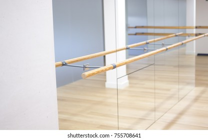 Barre pilates studio dance stretching bar for fitness workouts in gym.