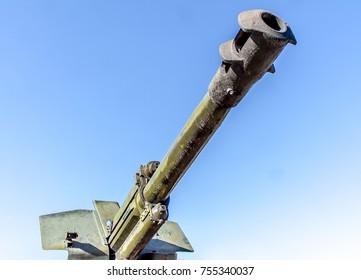 The barrel of an artillery gun against the sky
