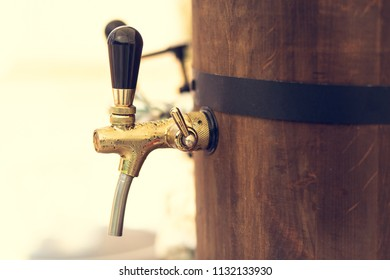 barrel with a beer tap