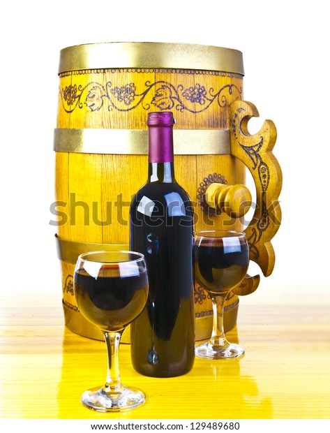 barrel, bottles and two glasses of wine isolated on white