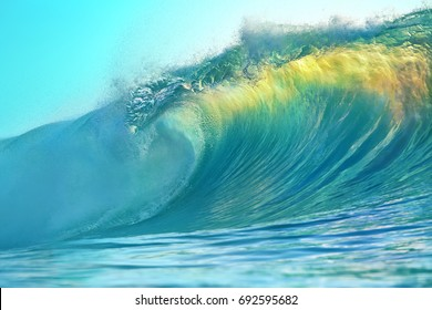 Barrel of bright colorful surfing ocean wave. Tropical background in sunset colors for sport activity with nobody on image.