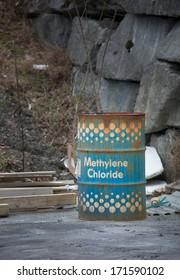 Barrel of chemical Methylene chloride stored unprotected