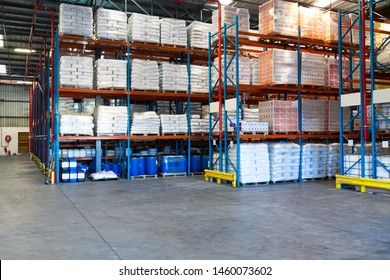 Barrel and goods arranged on a rack in warehouse. This is a freight transportation and distribution warehouse. Industrial and industrial workers concept