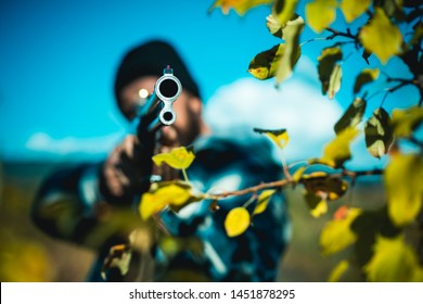 Barrel of a gun. Hunter aiming rifle in forest. Hunter with shotgun gun on hunt. Poacher with Rifle Spotting Some Deers. Hunting in spring forest
