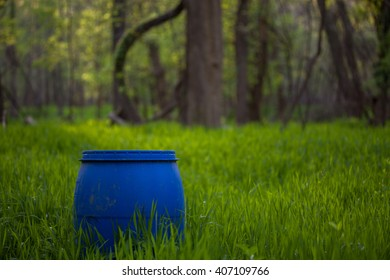 Barrel in Tall Grass in the Woods