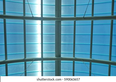 Barrel vaulted train station structure brings daylight in through its translucent roof panels.