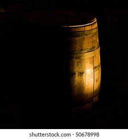 Barrel of wine in dark