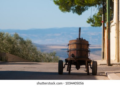 A barrel for the wine is drying outside in the village of Poggiorsini, Italy. Poggiorsini was a feud of the Orsini family and it is the smallest city center in the metropolitan city of Bari.