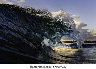 A barreling wave breaks on a fresh winter morning. Ocean, water, tube, sea, wave, seascape photography. Sydney, Australia