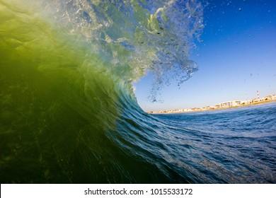 Barreling waves before sunset