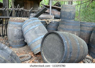 Barrels awaiting to be loaded from a low perspective