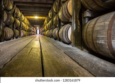 Barrels of Bourbon Whiskey in an aging cellar