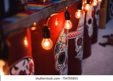 Barrels decorated in Mexican style. Sugar skulls Vintage light bulbs, Mesquican colors, Mexican atmosphere in a Mexican restaurant