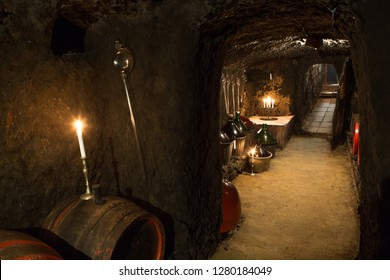 Barrels, and glass bottles in the wine cellar