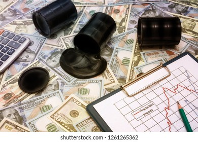 barrels of oil on the background of us dollar bills., oil production schedule. oil and petroleum products market