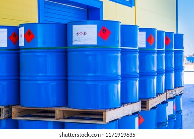 Barrels. Warehouse of chemical products. The metal barrels are blue. Chemistry. Manufacture of chemicals. Pallets with barrels.