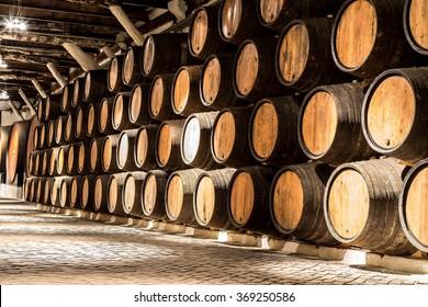 Barrels in the wine cellar in Porto in Portugal