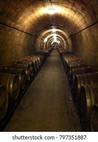 barrels of wine in an old wine cave in Spain.